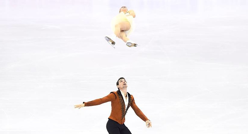 Chris Knierim sends partner Alexa Scimeca airborne at the Grand Prix final, where the couple had three falls in the free skate. (ISU photo)