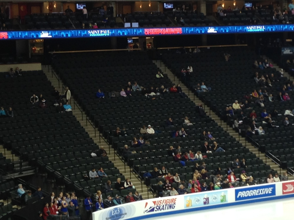 The sparse crowd for Friday night's men's short program at the XCel Energy Center.  Sections shown are just left of center ice.  (Philip Hersh photo)