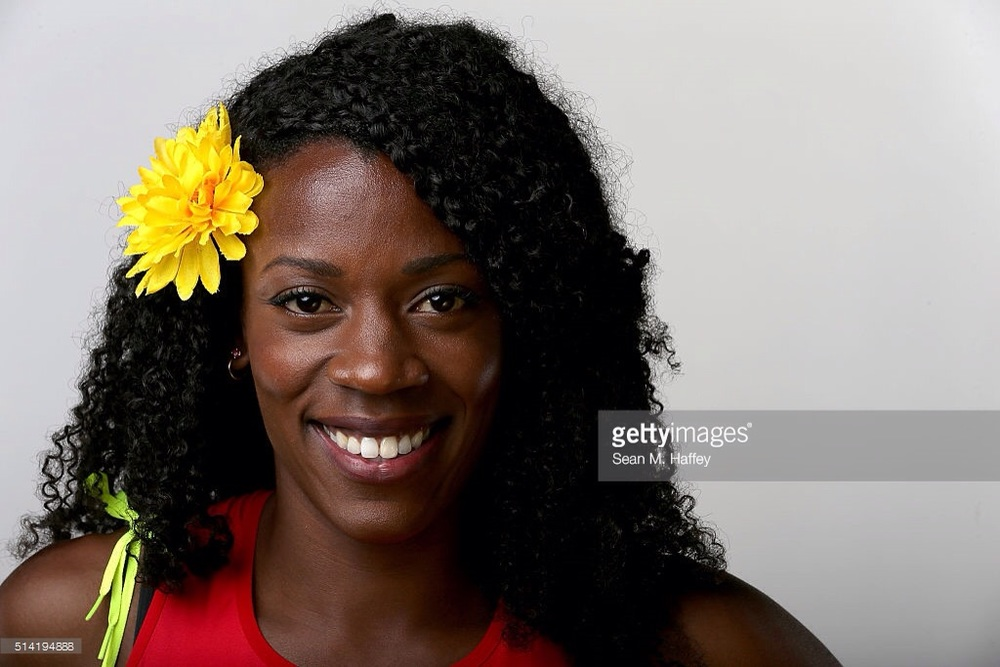 Alysia Montano, with trademark flower, at the USOC Media Summit (Getty Images)