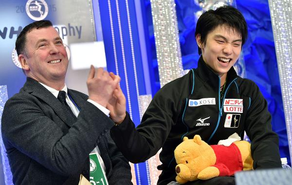 Brian Orser and Yuzuru Hanyu after the skater's record-breaking performance at the NHK Trophy last fall.  (Getty Images)