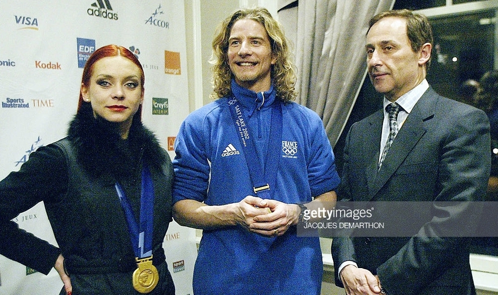 France's Didier Gailhaguet with French ice dance gold medalists Marina Anissina and Gwendal Peizerat at the 2002 Olympics, where Gailhaguet's involvement in influencing the dance and pairs results led to his three-year suspension from international skating.