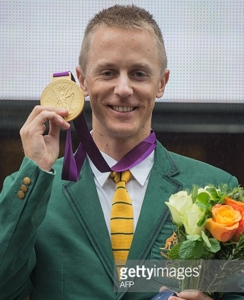 At a Friday ceremony in Melbourne, Aussie race walker Jared Tallent gets the 2012 Olympic gold medal inherited from a doping-disqualified Russian.  (Getty Images)
