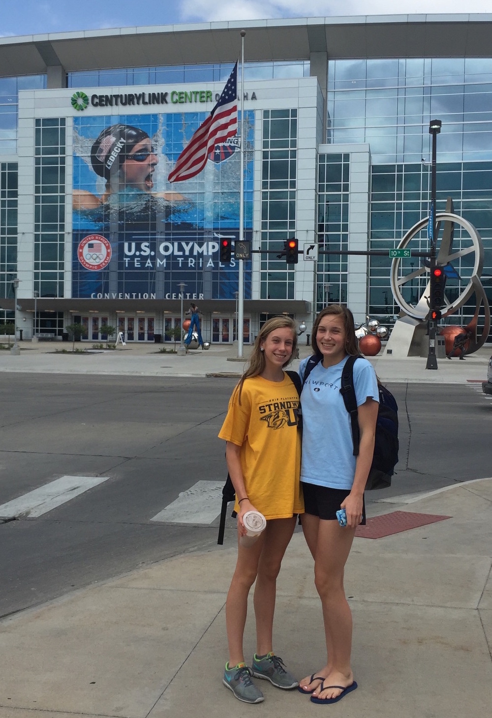Gretchen (l) and Alex Walsh in front of the huge Katie Ledecky mural outside the site of the 2016 Olympic swim trials.  (Photo courtesy Walsh family)