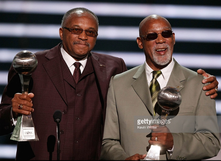 Tommie Smith (left) and John Carlos after receiving the Arthur Ashe Award for Courage at the 2008 ESPY Awards.
