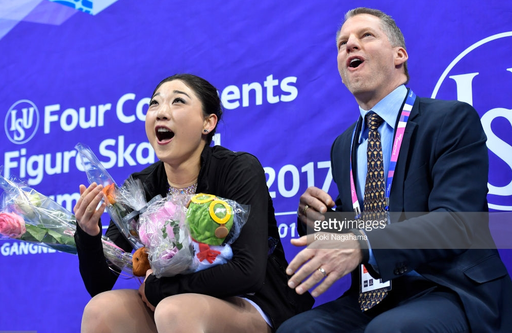 Mirai Nagasu and her coach exult over her free skate score Saturday at the Four Continents Championship in South Korea, where she won the bronze medal.