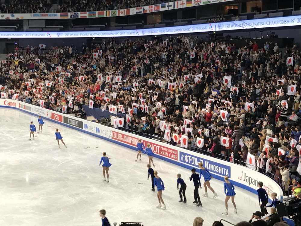 Japanese fans in Helsinki waved flags for not only their compatriots but their favorite skaters from many countries.  (Philip Hersh photo)