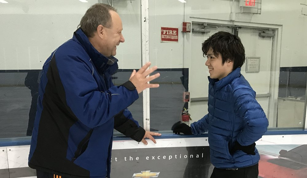 Alex Ouriashev (left) makes a point to Shoma Uno before a recent practice at the Glacier Ice Arena in Vernon Hills, IL  (Philip Hersh photo)