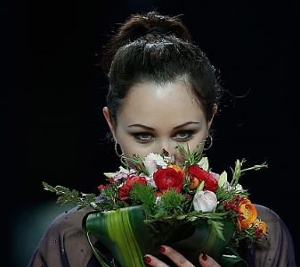 Russia's Elizaveta Tuktamysheva stops to smell the flowers after capping her stunning 2014-15 season with the world title.  (Getty)