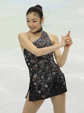"A sassy Yuna Kim in ""James Bond"" medley short program at the 2010 Olympics. (Getty)"