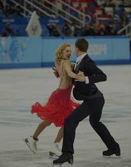 Russians Ekaterina Bobrova and Dmitri Soloviev at the Sochi Olympics, where they won a team gold medal.  (Getty Images)