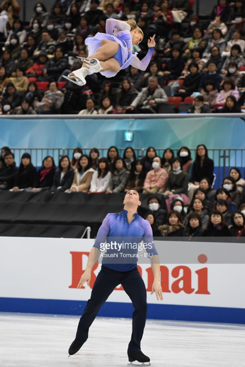 (H)Air-raising:  Bruno Massot looks heavenward to see partner Aliona Savchenko on the triple twist at Grand Prix Final.