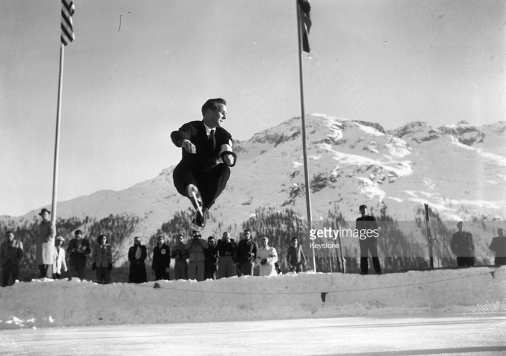 Dick Button soars above the ice in his gold-medal skate at the 1948 Winter Olympics in St. Moritz, Switzerland.  He won again in 1952. (Getty Images)