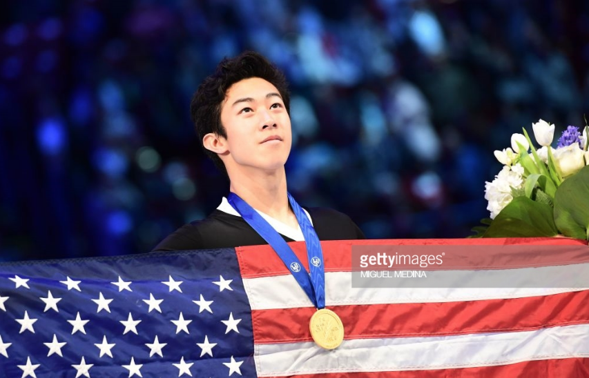 Nathan Chen with Old Glory and new glory - his gold medal at the World Championships.