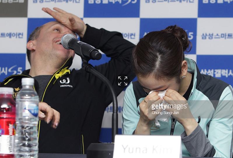 David Wilson and a tearful Yuna Kim at the South Korean skater's 2014 retirement press conference.