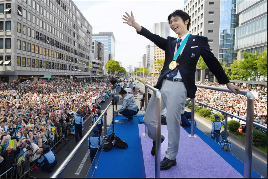 More than 100,000 turned out to salute two-time Olympic men's singles champion Yuzuru Hanyu in his native Sendai, Japan. (Getty Images.)