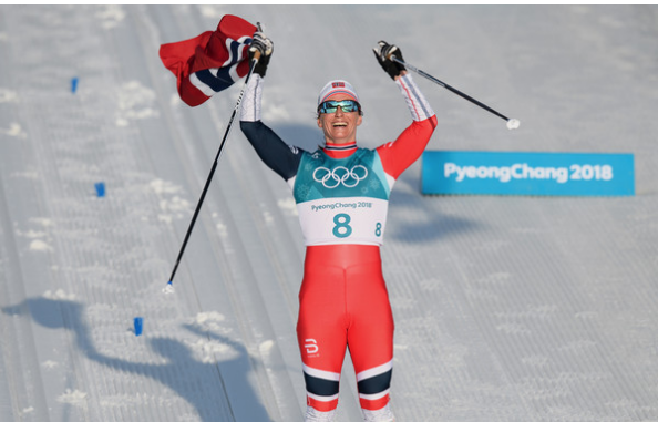 Marit Bjørgen of Norway celebrates her record-tying eighth Winter Olympic gold medal. (Getty Images.)
