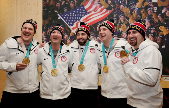 Curling gold medalists Matt Hamilton, John Shuster, John Landsteiner, Tyler George and Joe Polo celebrate at USA House. (Getty Images)
