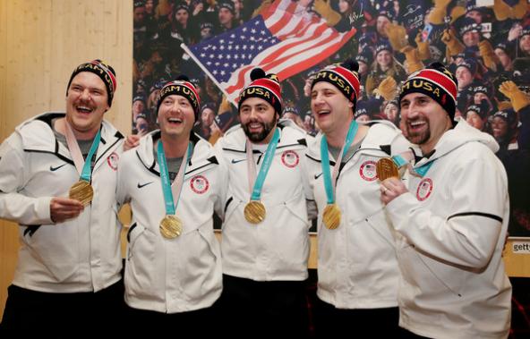 Curling gold medalists Matt Hamilton, John Shuster, John Landsteiner, Tyler George and Joe Polo celebrate at USA House. (Getty Images)