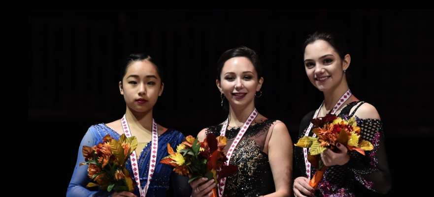 Elizaveta Tuktamysheva (center) won 2018 Skate Canada, with compatriot Evgenia Medvedeva (right) third and Mako Yamashita (left) of Japan second. (ISU / Getty Images.)