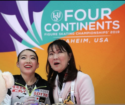 Rika Kihira and coach Mi Hamada after seeing her winning scores. (Getty Images)