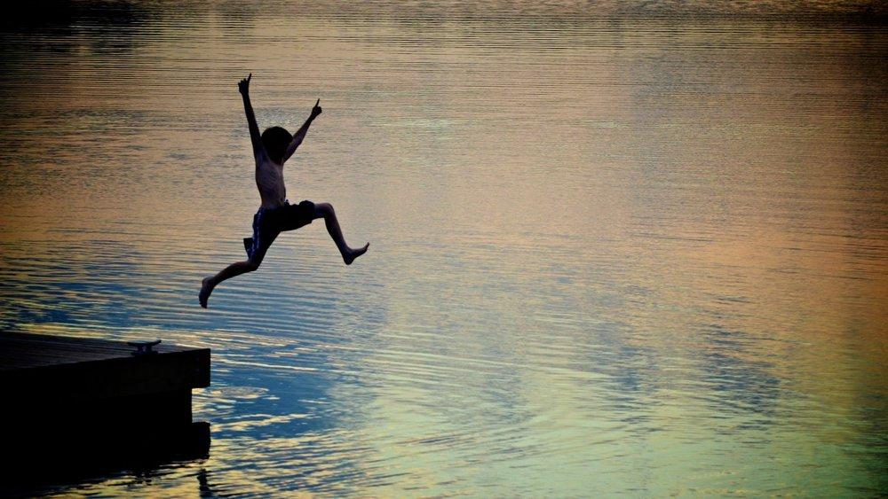 kids-jumping-off-dock-sunset_h.jpg