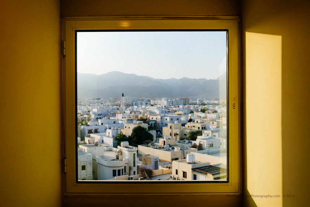 The morning light illuminates the city of Muscat.
