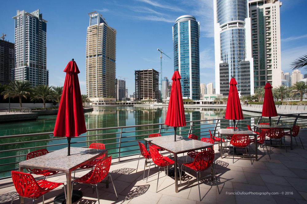 Red chairs and umbrellas in JLT (Dubai, UAE)