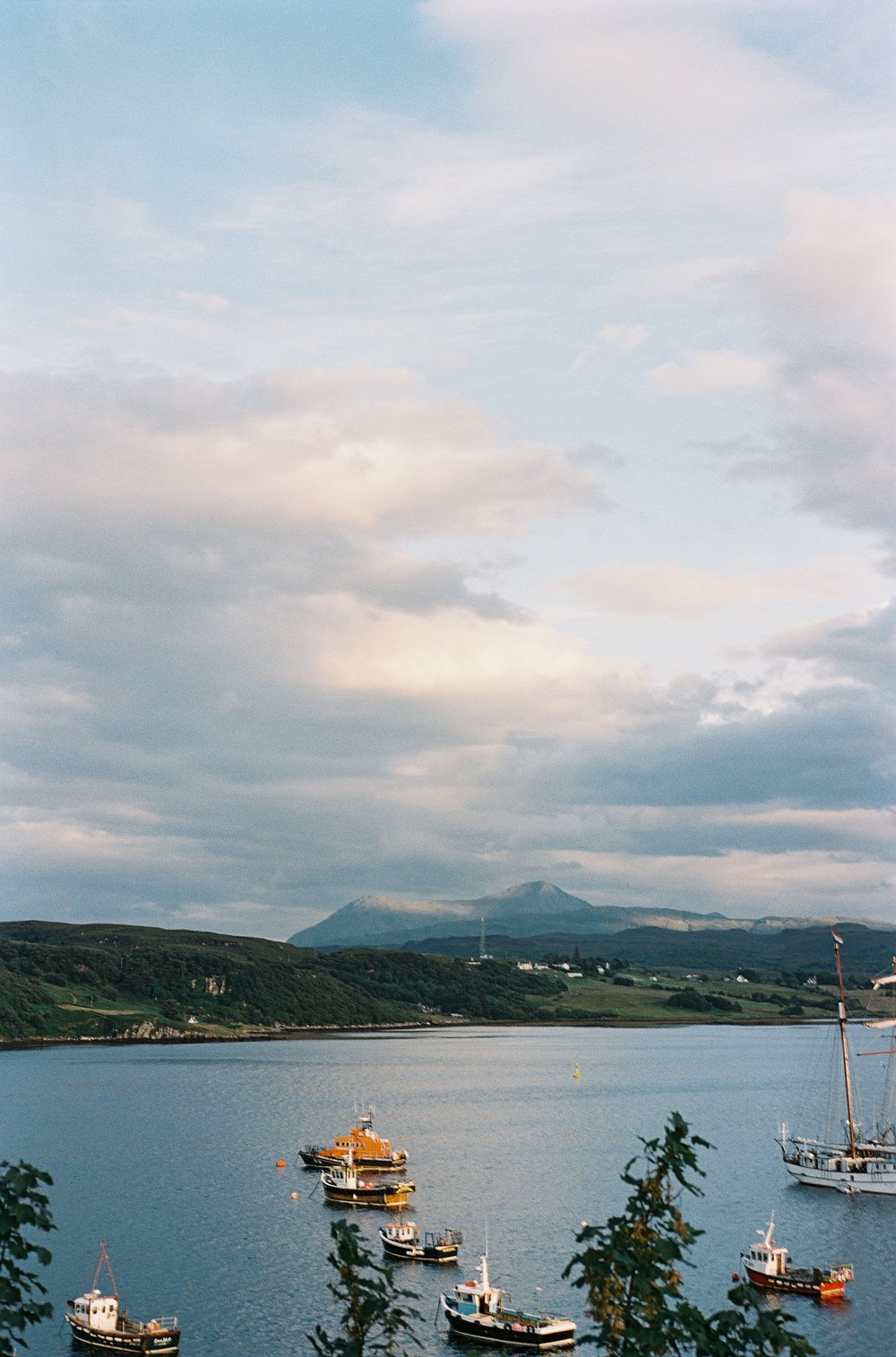 one of the most carelessly stunning places I've ever been - On the day we arrived in Portree, we arrived right as the sun began to set, the surrounding hills and tiny cars silhouetted against a quickly purpling evening sky.