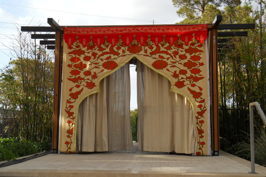 Honey Glow and orange mughal arch with red calloping and mocca drapes.jpg