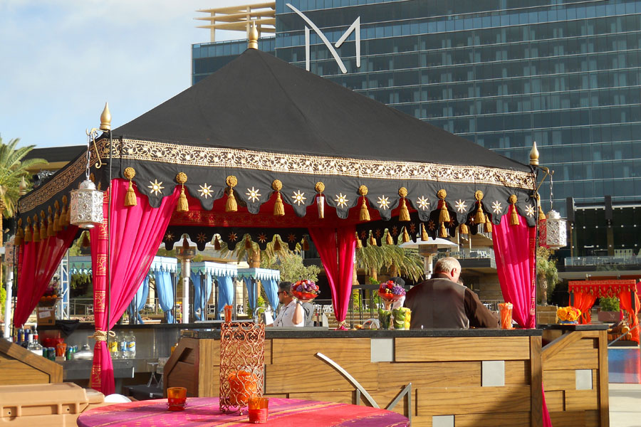 Black and hot pink pergola bar with silver perimeter lamps.jpg