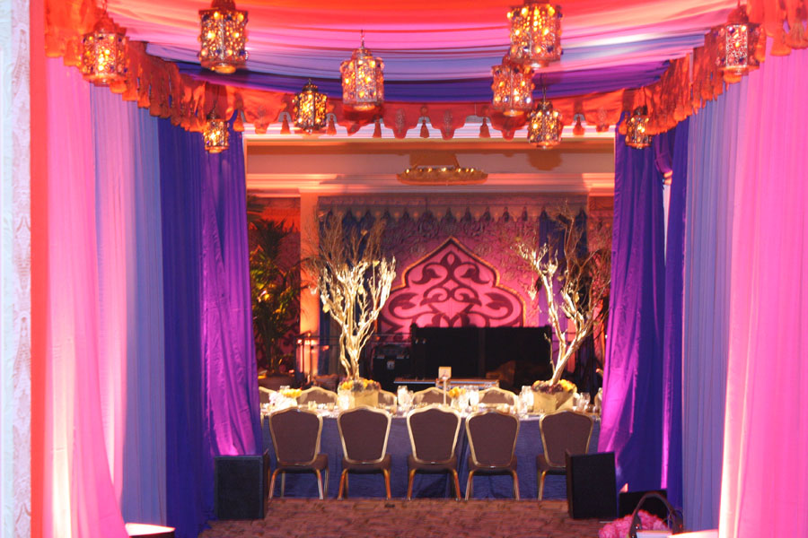 ballroom entrance drape and lamp treatment with scalloping.jpg