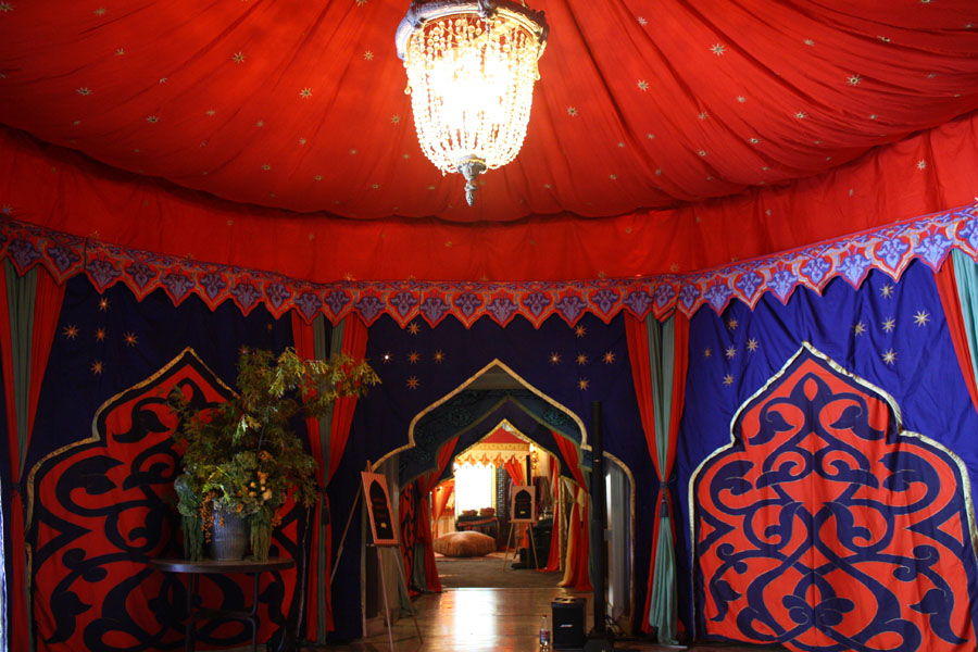 custom canopy in red with gold star and moorish arch walls.jpg