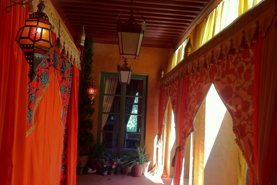 Red and orange mughal arch treatment with marakesh lamps on deck.jpg