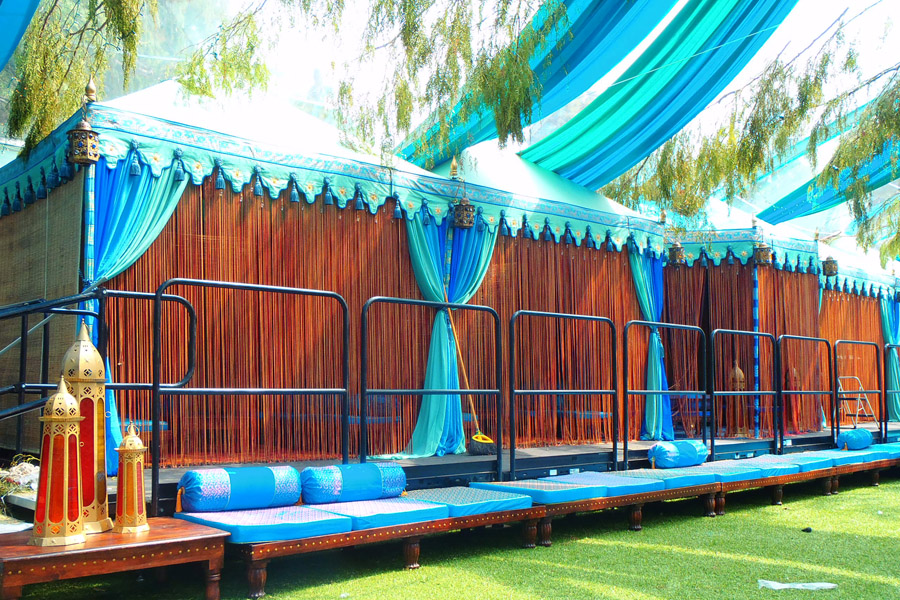 Aqua tone Pergola VIP lounges with silk string fronts.jpg