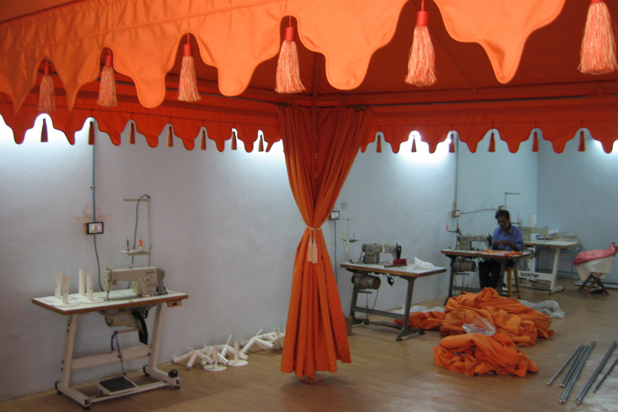Final touches on Tangerine tent.jpg