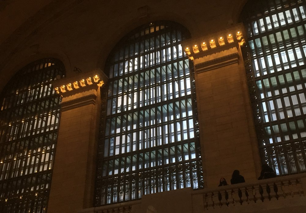 The amazing windows at Grand Central Terminal where you can often see people walking through the glass catwalks that pass through the middle of these amazing double window / corridors.