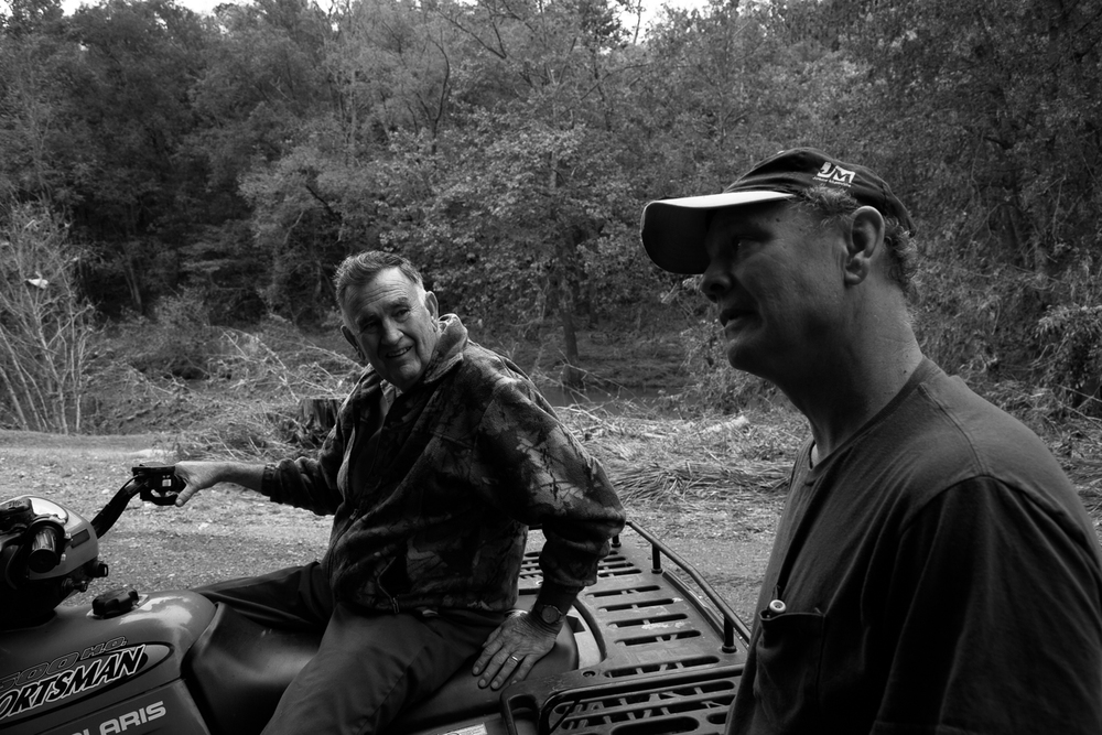 Oct 1. 2015 - A neighbour swings by on his ATV to look at the damage and check on people by the river. He and Elmer discuss the impending rain from hurricane Joaquin working it's way up the East Coast. Both are wondering how the road will fare under more pressure.