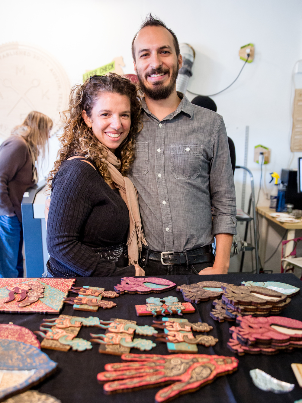 Artist Mark Puente and his wife, Amy Exah, during their E.A.S.T. 2015 show at MakeATX in Austin, Texas.
