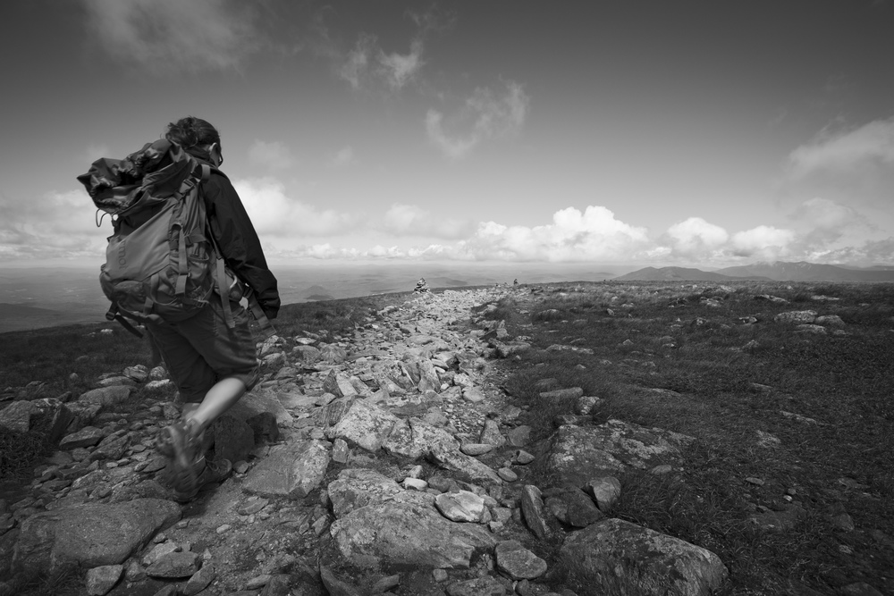 A hiker on the summit of Mt Moosilauke