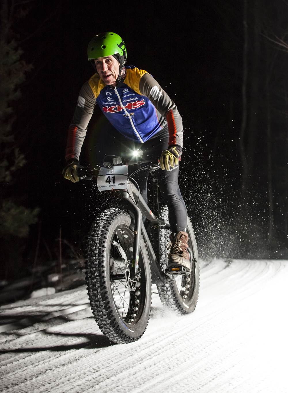 A rider spraying snow at the Polartec Winter Fat Bike Series