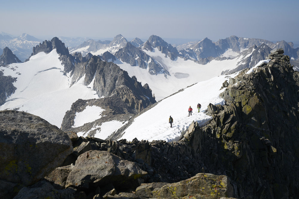 Adventure photography of climbers on Gannett Peak