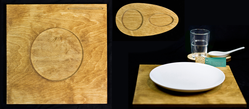 The dining tray and coaster remain on the table for the duration of the meal. The dishes and instructional cards are switched in and out.