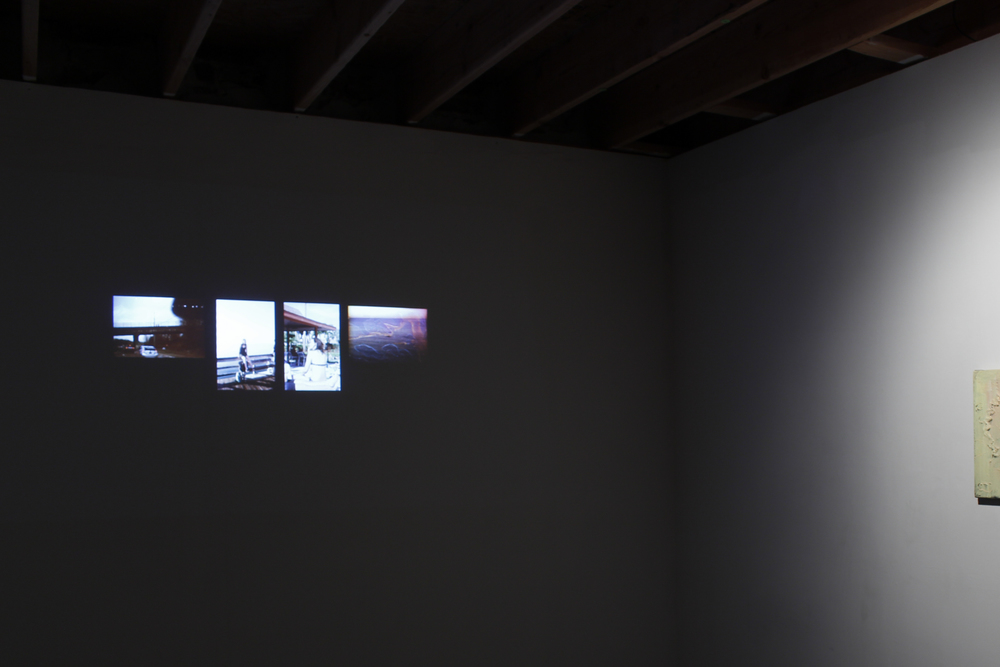 Installation view,Unemployed, 2005-2015, slideshow on single channel projection