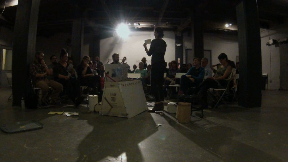 Still for documentation of M-OSRISC, First Model Demonstration (The Manually-Operated Somewhat Random Image Selection Container)  Live demonstration performance, 2014