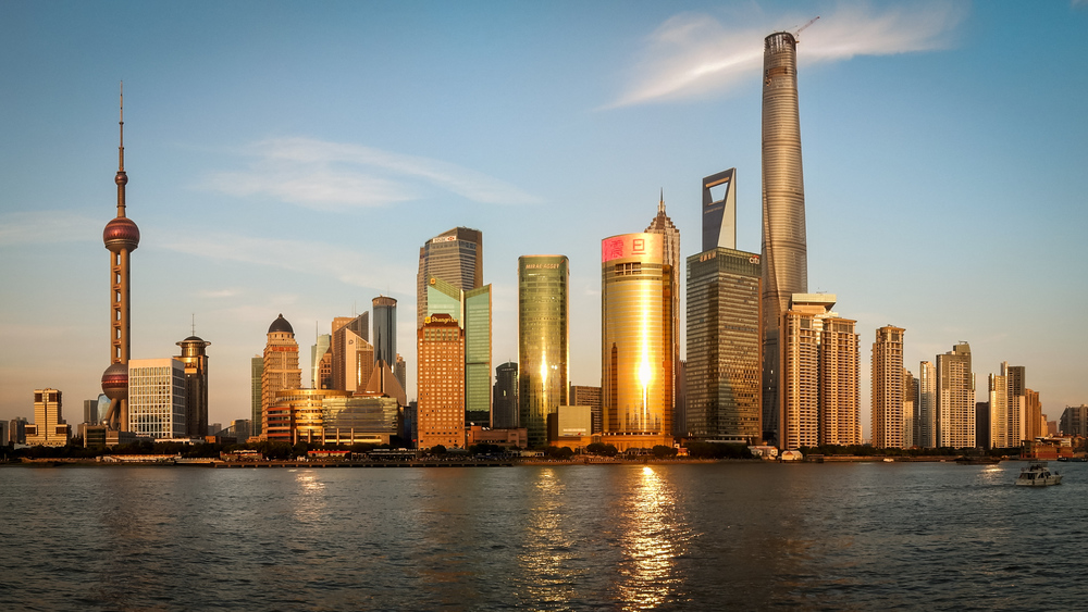 View of Pudong's skyline in Shanghai.  Image by Pjt56 , derivative work by NR and licensed under CC BY-SA 4.0.