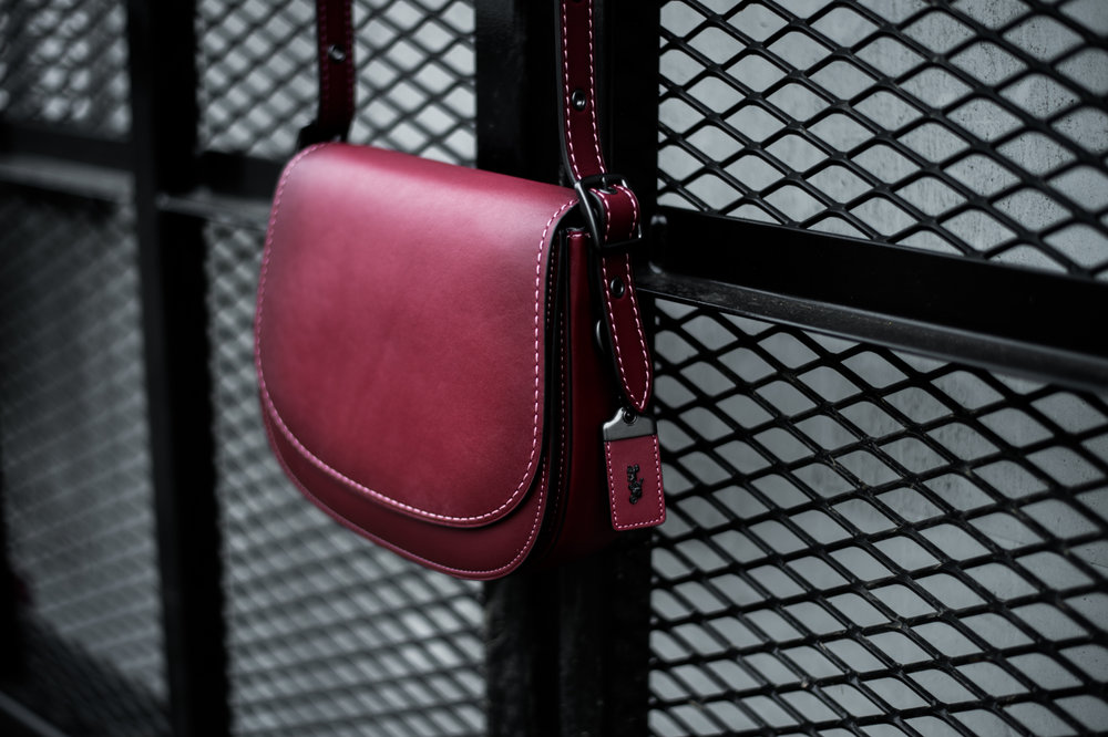 Saddle Bag 23:  First introduced in 1972 and beloved throughout the years, the simple and timeless Coach Saddle Bag is luxuriously updated for the 21st century in very refined glovetanned leather with a soft leather lining and pop-color contrast stitching.
