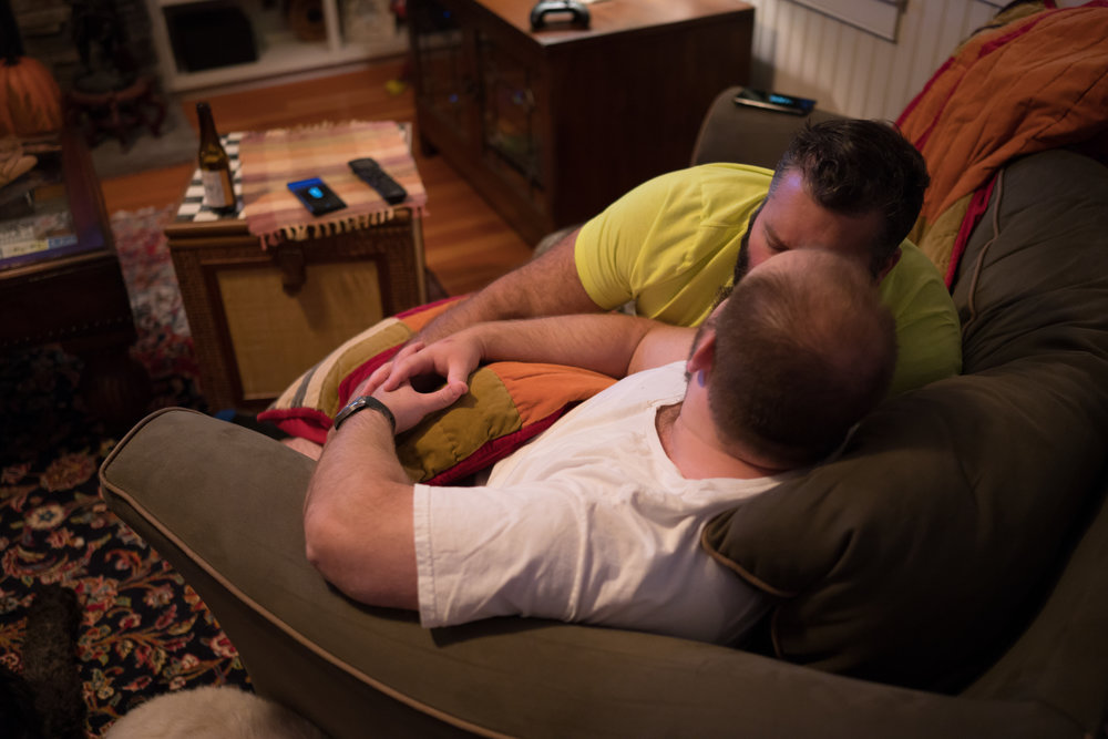 Thomas McCue and Sean Bresnahan share a quiet kiss in the living room of their home in Parish, N.Y. The two are kids at heart – watching suphero and old Disney movies is a common night in. Their three labradoodles Maxwell, Oliver and Jack are always at their sides.