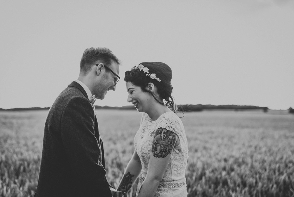 bride and groom laughing in cornfield hertfordshire wedding couples portraits