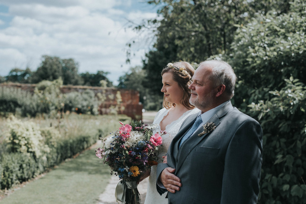 Bride and Bride father walking down the aisle Laura and Helgi Intimate secret garden Kent wedding