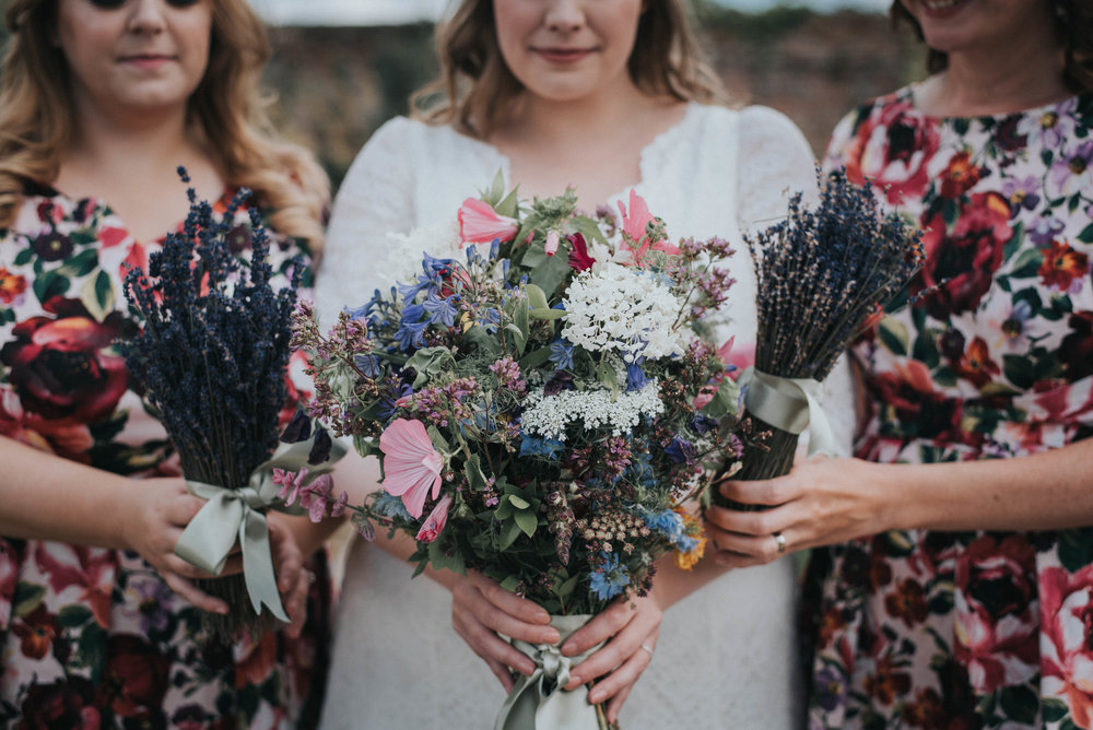 Bridal party with lavender and wild flower boutiques